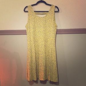Yellow dress with blue flower pattern